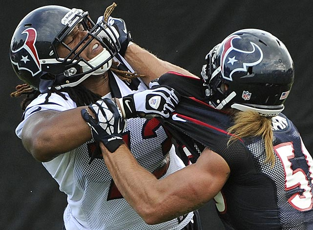 Houston Texans Brennan Williams (73) and Bryan Braman (50) square off during a drill.