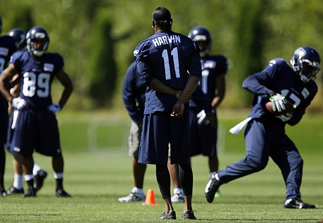 Injured Seattle Seahawks wide receiver Percy Harvin watches as other receivers go through practice drills. Harvin will get a second opinion on his sore hip next week in New York, and Seattle coach Pete Carroll says all options remain for how the injury is handled.