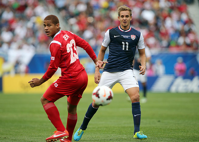 Stuart Holden (right) exited the United States' match against Panama with an injury in the 23rd minute.