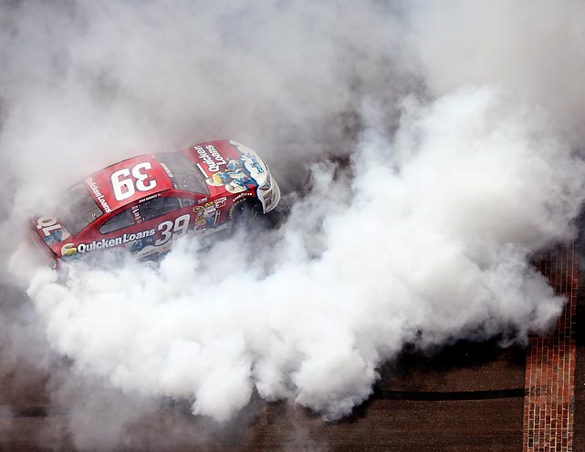Ryan Newman celebrates with a burnout after winning the Sprint Cup race at The Brickyard on July 28.