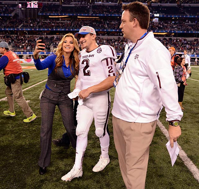 Manziel stops to pose for a photo with a credentialed fan.