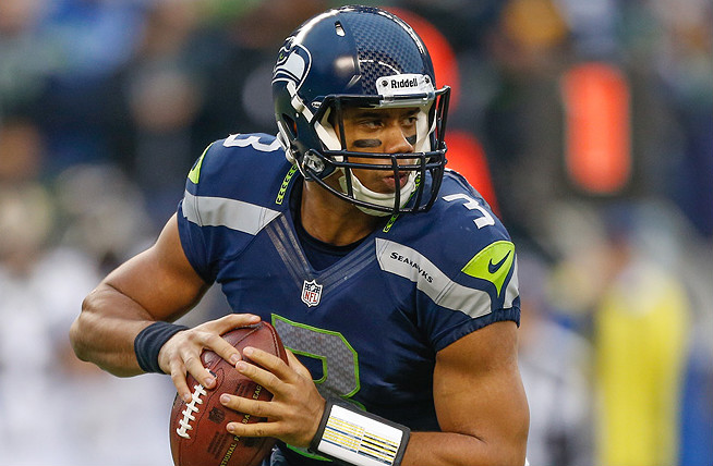 Russell Wilson threw for 3,118 yards, 26 touchdowns and 10 interceptions last season for Seattle.