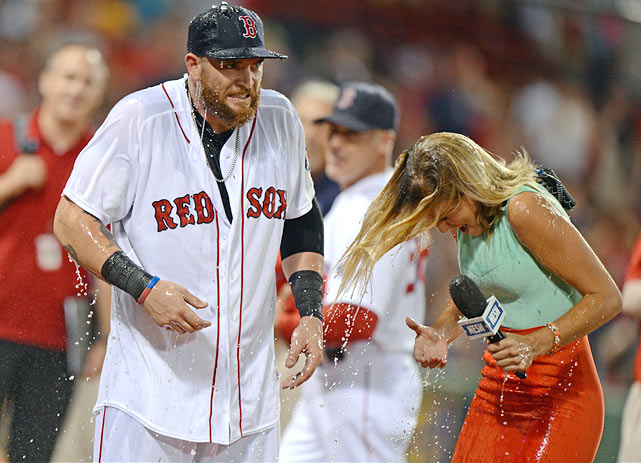 Jonny Gomes and sideline reporter Jamie Erdahl are doused after his pinch-hit walk-off home run in the ninth inning of the Red Sox 2-1 win over the Padres.