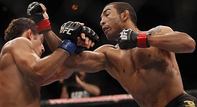 Jose Aldo (right) fights in his home country Saturday night and is favored to win.