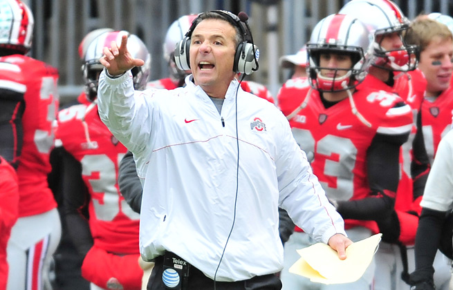 Urban Meyer leads a Buckeyes team with national title hopes after going undefeated in 2012.