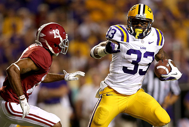 "LSU coach Les Miles reinstated Hill after he says the team, ""waited for [the] legal system to act."""