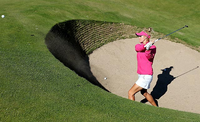 Carly Booth of Scotland chips out of the Road Hole bunker at the 17th hole during final practice before the Ricoh Women's British Open at St. Andrews on July 31.