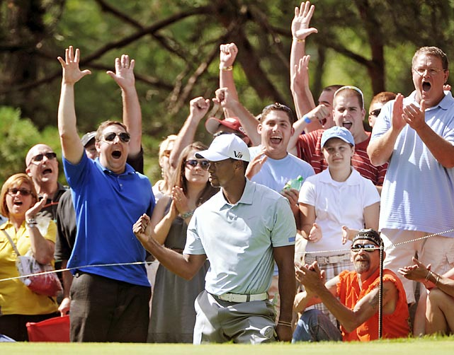Fans celebrate with Tiger Woods after a chip-in for a birdie on hole 13 at Firestone on Saturday, Aug. 3. Woods finished at 15-under par, seven strokes ahead of the competition.