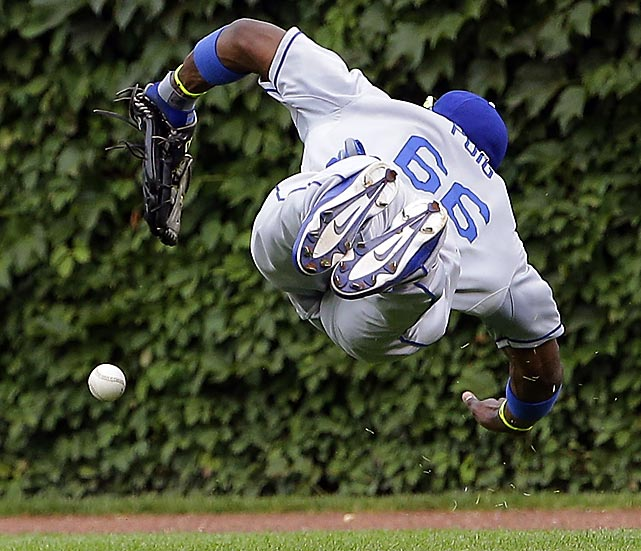 Dodgers right fielder Yasiel Puig dives for a double hit by Chicago's Cole Gillespie at Wrigley field on Aug. 2.