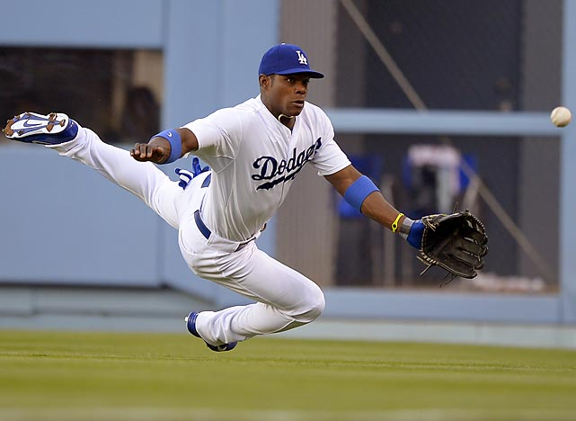 The Dodgers' Yasiel Puig dives for a Vernon Wells single during a game against the Yankees on July 31 in Los Angeles.
