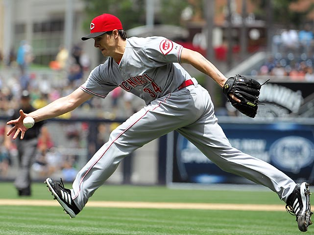 Cincinnati Reds pitcher Homer Bailey collects a ball hit by Chris Denorfia of the San Diego Padres in a 4-1 Reds win at Petco Park on July 31.