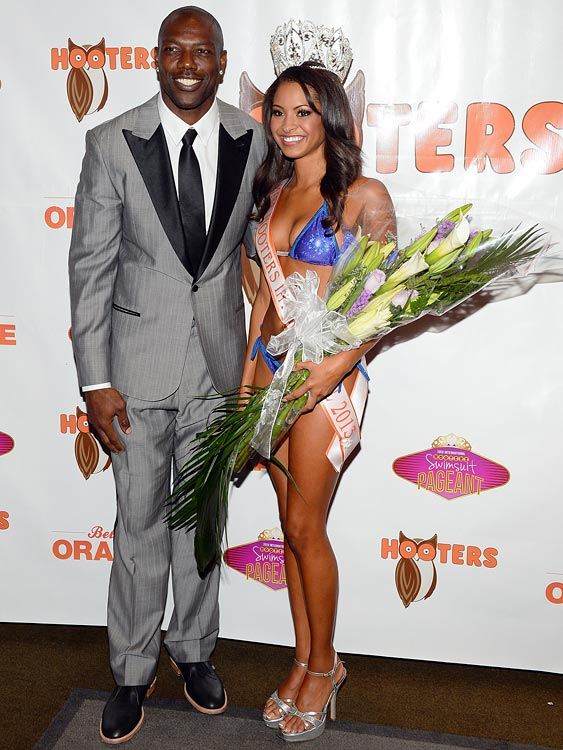 Owens poses with Marissa Raisor, the newly crowned Miss Hooters International 2013, at the 17th annual Hooters International Swimsuit Pageant on June 27, 2013 in Las Vegas.