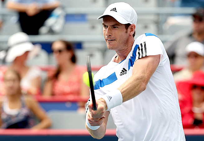 Andy Murray was victorious in his first match since winning the Wimbledon title.