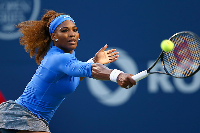 Serena Williams beat Italy's Francesca Schiavone 6-3, 6-2 to advance in Toronto.
