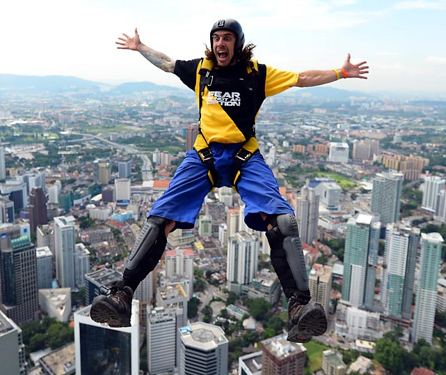 Australian base-jumper Chris McDougall leaps from the top of the 421-meter Kuala Lumpur Tower during the International Tower Jump. Ninety-five professional base-jumpers from 18 countries took part.