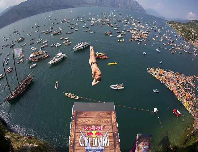 David Colturi dives from a 27-meter platform at the Scaliger Castle Red Bull Cliff Diving World Series in Malcesine, Italy.