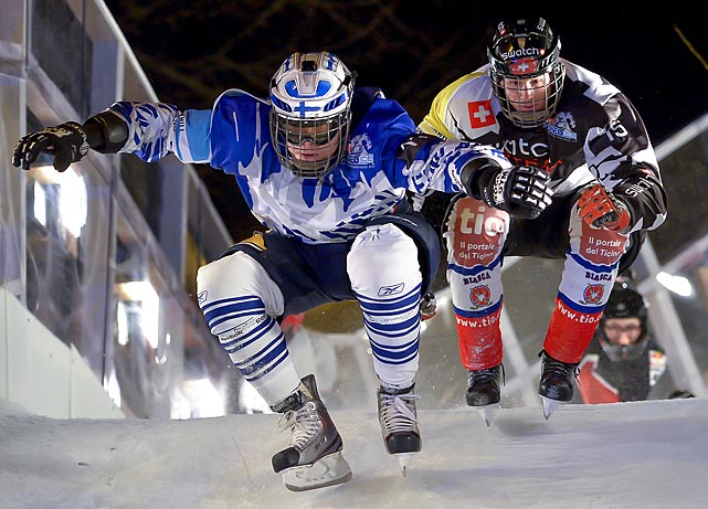 Finland's Lari Joutsenlathi (left) and Switzerland's Kim Mueller compete during the finals of the Ice Cross Downhill World Championships in Lausanne, Switzerland.