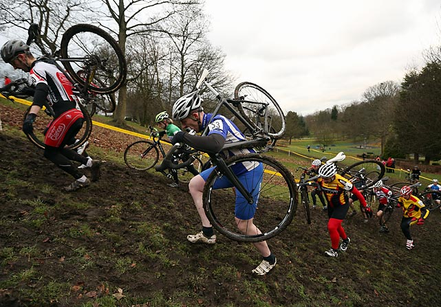 Competitors run up a hill as they take part in the National Cyclo-Cross Championships in Bradford, England.