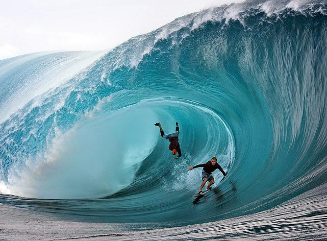 Garrett McNamara (left) and Mark Healy of the United States compete during a free session on the southern Pacific Ocean island of Tahiti.