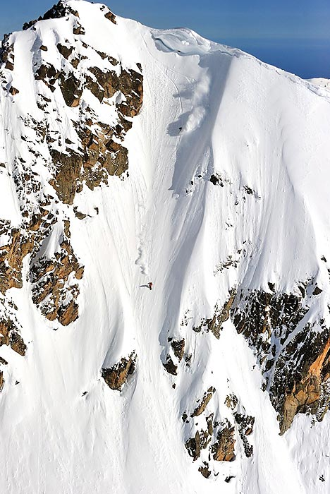 Paul Henri de le Rue snowboards down a mountain in Pyrenees, France.