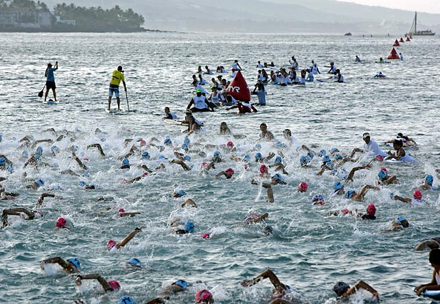A large amateur group of Ironman athletes compete in the early morning 2.4-mile swim in Kailua Bay during the Ironman World Championship in Kailua-Kona, Hawaii.