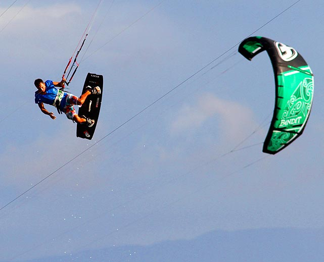 A kite surfer competes during a free session at El Hyaque Beach in Isla Margarita, Venezuela.