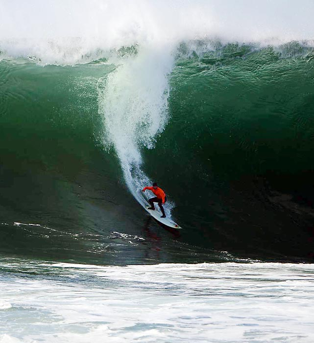 A competitor surfs at the Maverick Invitational big-wave surfing contest in Pillar Point Harbor, Calif.