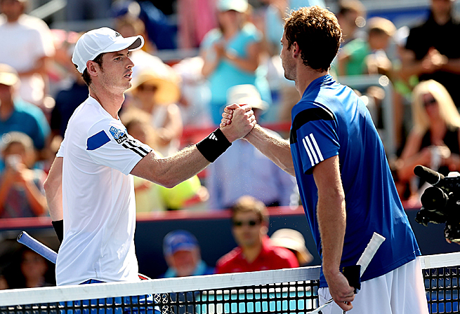 Reigning Wimbledon champion Andy Murray goes down 6-4, 6-3 to Ernests Gulbis in Montreal.