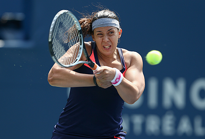 Marion Bartoli pulled out during her third-round match against Magdalena Rybarikova at the Rogers Cup.