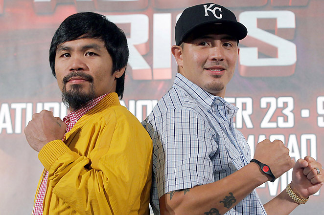 Pacquiao (L) is coming off losses to Timothy Bradley and Juan Manuel Marquez, followed by 11 months of inactivity.