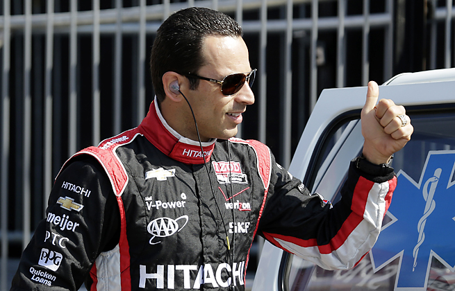 Helio Castroneves emerged from a stock car crash in Brazil with minor injuries to his back and legs.