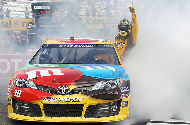 On a two-lap dash to the finish in the caution-filled Sprint Cup race, Busch held off Brad Keselowski.