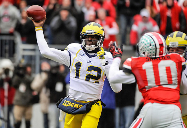 With Denard Robinson gone, quarterback Devin Gardner (12) will lead Michigan's new pro-style offense.