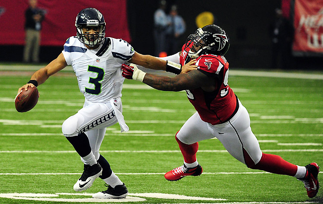 Seattle's Russell Wilson will be a relatively high pick in 2013 drafts, but an absolute steal in auctions.