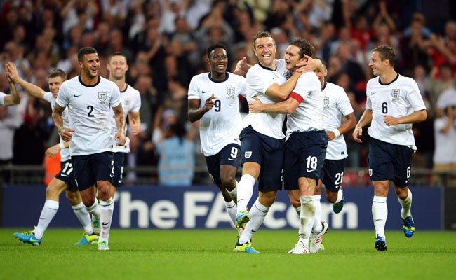 Rickie Lambert celebrates with Frank Lampard (18) after scoring a game-winning goal.