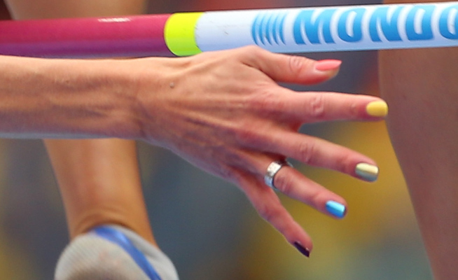 "High jumper Emma Green Tregaro said her rainbow-colored nails ""show what I stand for."""