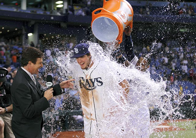 Wil Myers is doused by teammate Yunel Escobar during an interview with reporter Barry Lebrock. Myers hit a walk-off single in the 10th inning to give the Rays a 2-1 win over the Giants.