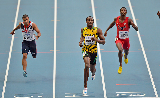 Usain Bolt cruised to a victory in the men's 200-meters while American Curtis Mitchell finished third.