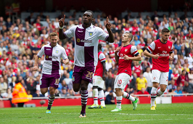 Christian Benteke scores the second of his two goals during Aston Villa's 3-1 win over Arsenal.