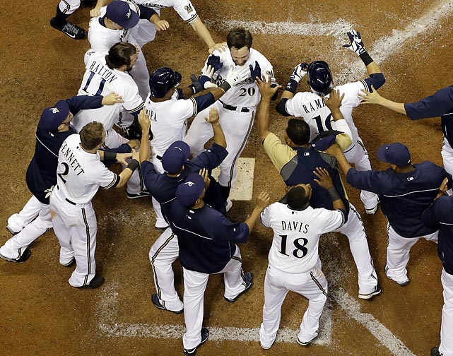 Milwaukee Brewers' Jonathan Lucroy is mobbed by teammates after hitting a walkoff two-run home run against the Cincinnati Reds on Aug. 16. The Brewers won 7-6.