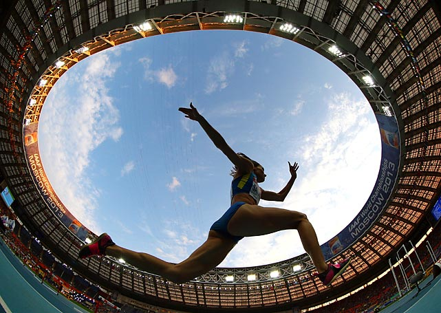 An athlete competes in the triple jump final during Day 6 of the 14th IAAF World Athletics Championships in Moscow.