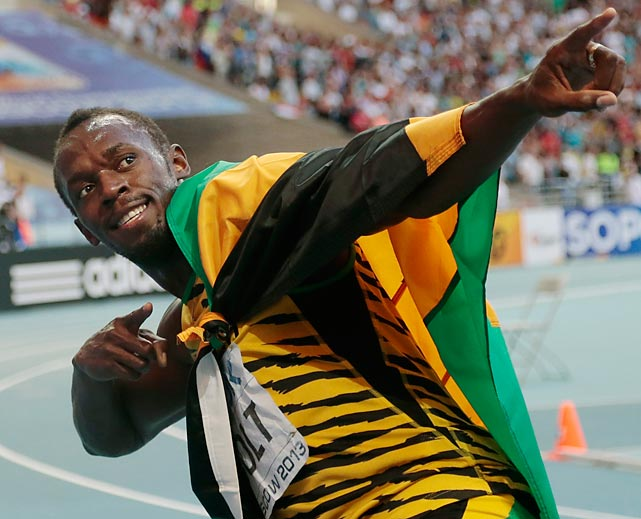 Usain Bolt celebrates winning gold in the 200-meter final at the World Championships.