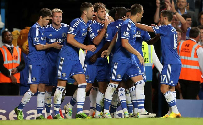 Branislav Ivanovic (fourth from left) is congratulated after his second-half goal.