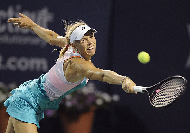 After a tiebreak in the first set, Caroline Wozniacki cruised to victory against Sloane Stephens.