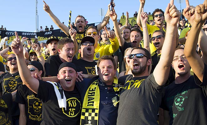 New Crew owner Anthony Precourt (center) observed a recent game with the club's most ardent fans.