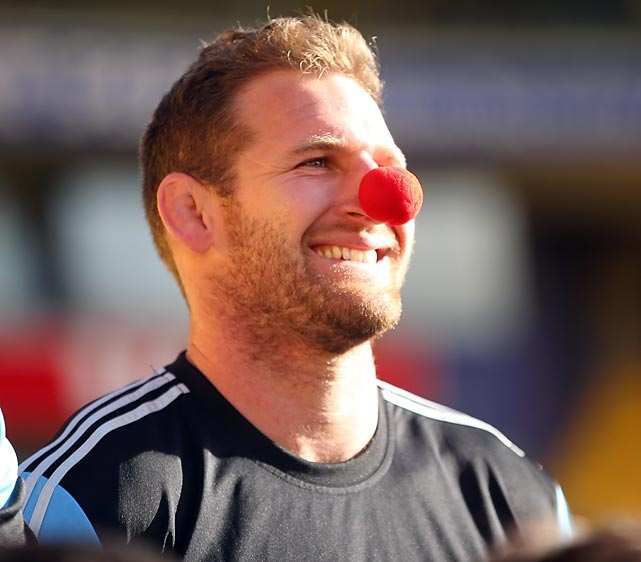 The All Blacks loose forward proudly displays his world class whiskey nose during the team's Captain's Run for charity at Westpac Stadium in Wellington, New Zealand.