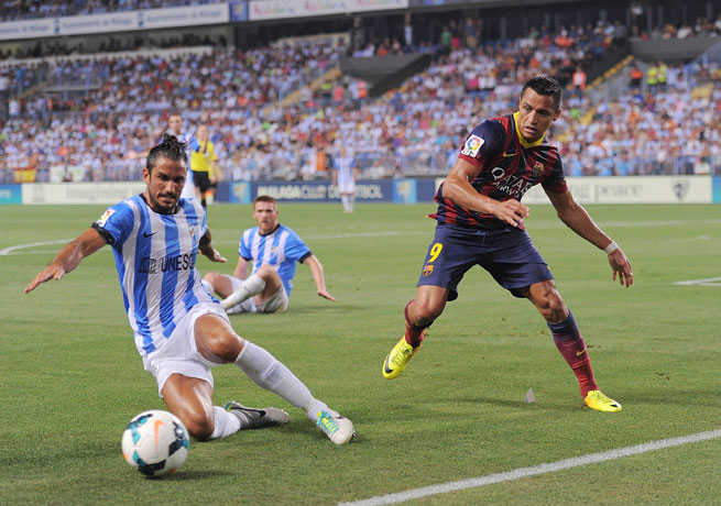 Adriano (right) scored the game's lone goal for Barcelona in the 44th minute against Malaga.