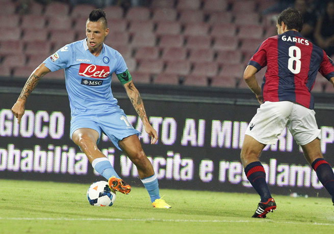 Marek Hamsik (left) scored on either side of halftime to help Napoli to victory over Bologna.