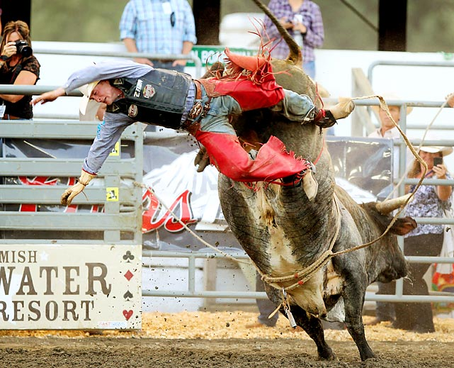 Cheyne Olney loses his grip of Blue Light Special in the first round of the Extreme Bulls at the Kitsap County Fair and Stampede Rodeo in Bremerton, Washington.