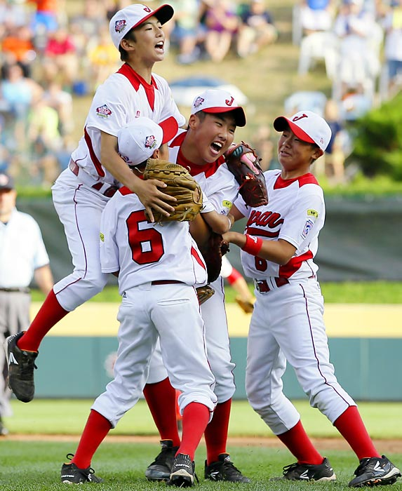 Japan players celebrate after winning the Little League World Series against California. Japan won 6-4.